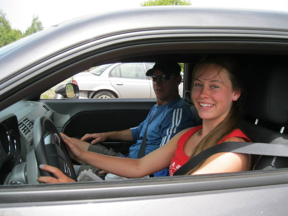 Young woman learning to drive.
